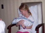 Emmie holding Carter for the first time