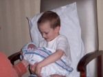 Calvin holding Carter for the first time