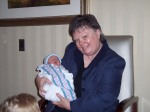 Grannie holding Carter for the first time