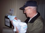 PawPaw holding Carter for the first time